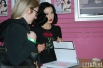 Dita signs her book for fans